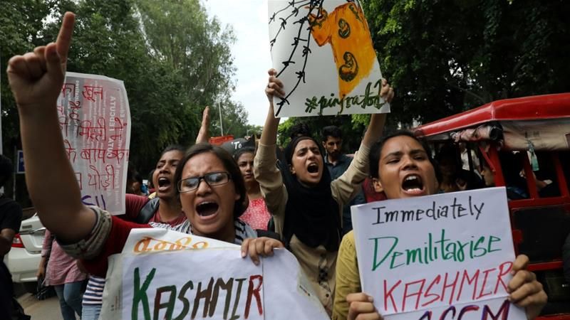 Students display placards and shout slogans during a protest against the scrapping of the special constitutional status for Kashmir by the government, in New Delhi [Anushree Fadnavis/Reuters]
