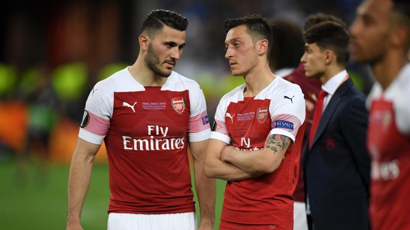 Sead Kolasinac, left, and Mesut Ozil, right, escaped an attempted carjacking in late July in London [Michael Regan/Getty Images]