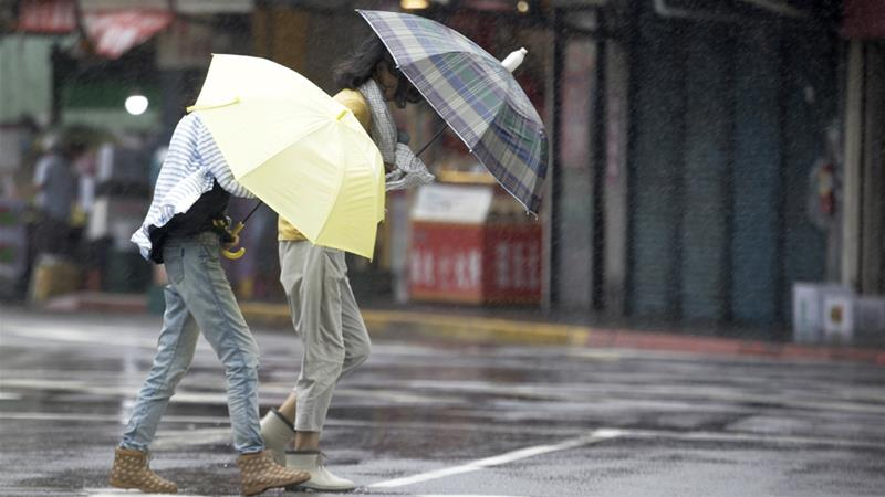 Rains from Typhoon Lekima hit Taiwan on Friday [Chiang Ying-ying/The Associated Press]