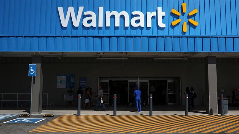 Retail giant Walmart is under pressure to curb its offerings of firearms after two deadly mass shootings in the United States that left 31 people dead [Jose Cabezas/Reuters]