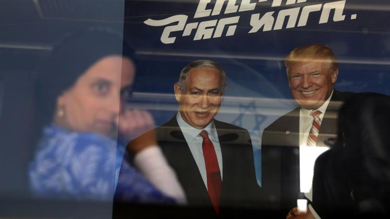 The latest polls suggest Israel may end up with a unity government that brings together Netanyahu's Likud and Gantz's Blue and White party [Ammar Awad/Reuters]