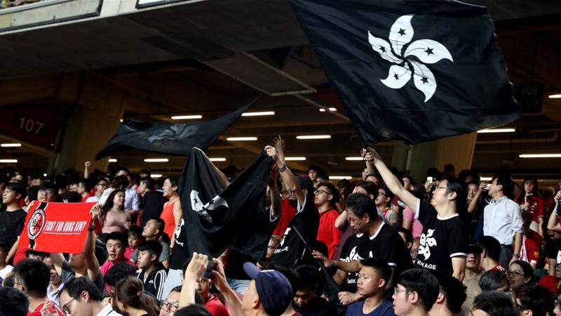 Hong Kong: Demonstrators boo Chinese anthem at football qualifier