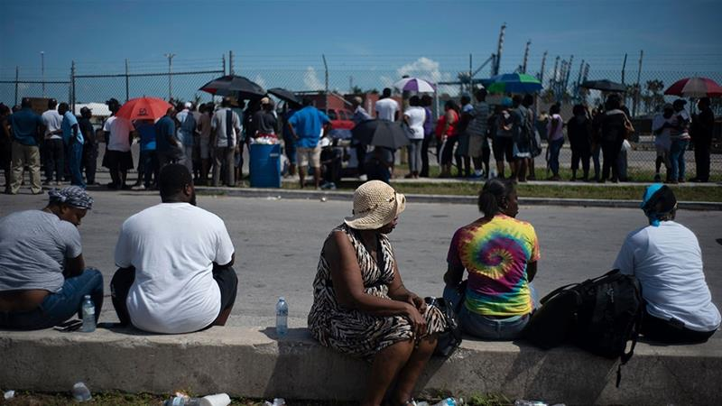 People gather at the port for aid sent by family members and friends in the aftermath of Hurricane Dorian in Freeport, Bahamas [Ramon Espinosa/AP Photo]