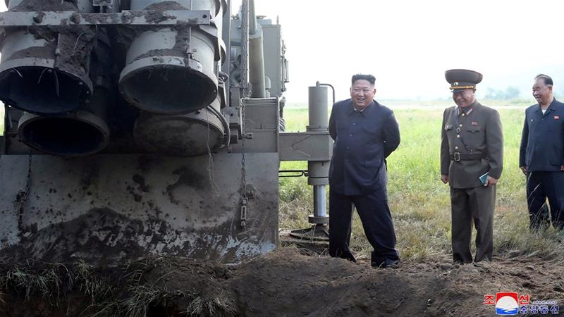 North Korean leader Kim Jong Un attends the testing of a super-large multiple rocket launcher in North Korea, in this undated photo released on September by North Korea's Korean Central News Agency (KCNA). Experts say South Korea's military expansion is worrying the North. [KCNA via Reuters]