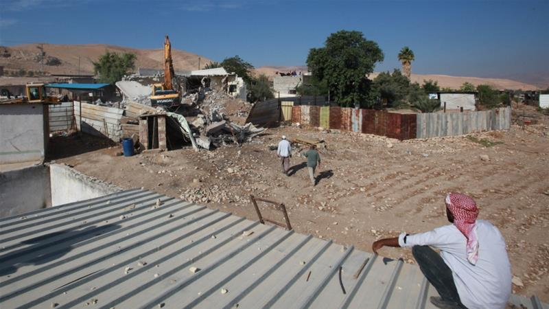 A Palestinian watches the demolition of his house from a roof at a farm north of the Jordan Valley in Tubas, in the occupied West Bank [File: Nedal Eshtayah/Anadolu]