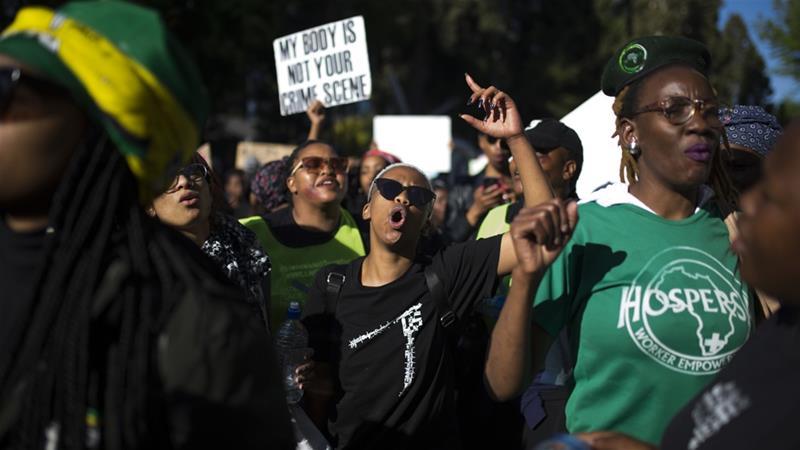 Demonstrators took to the streets of Cape Town on Friday to protest violence against women [Guillem Sartorio/AFP]