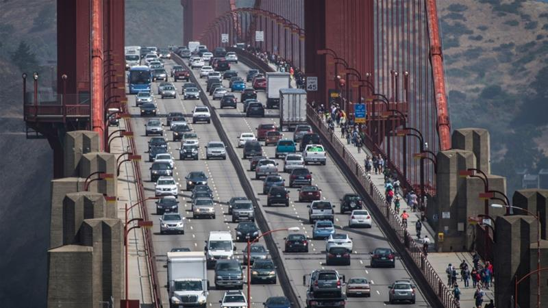 California and other states had previously promised to enforce stricter Obama-era emissions standards, after Trump proposed rolling back the federal rules [File: David Paul Morris/Bloomberg]