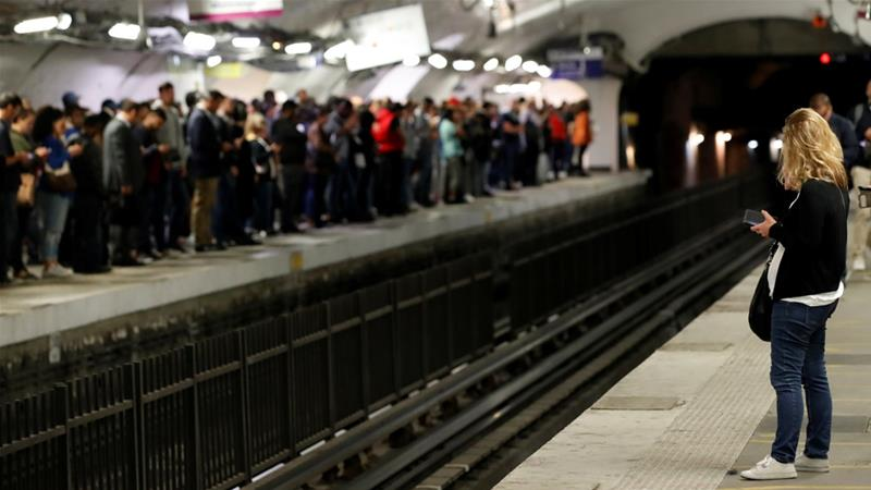 Commuters have been walking, cycling or taking scooters to try and get to and from work, while others were asked to work from home [Christian Hartmann/Reuters]