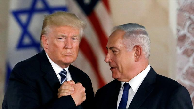 Trump and Netanyahu shake hands after Trump's address at the Israel Museum [File: Ronen Zvulun/Reuters]