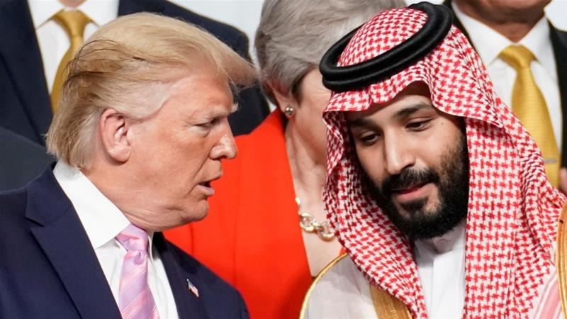 The Saudi crown prince, right, received a telephone call from Trump in the wake of the Houthi drone attack [File: Kevin Lamarque/Reuters]