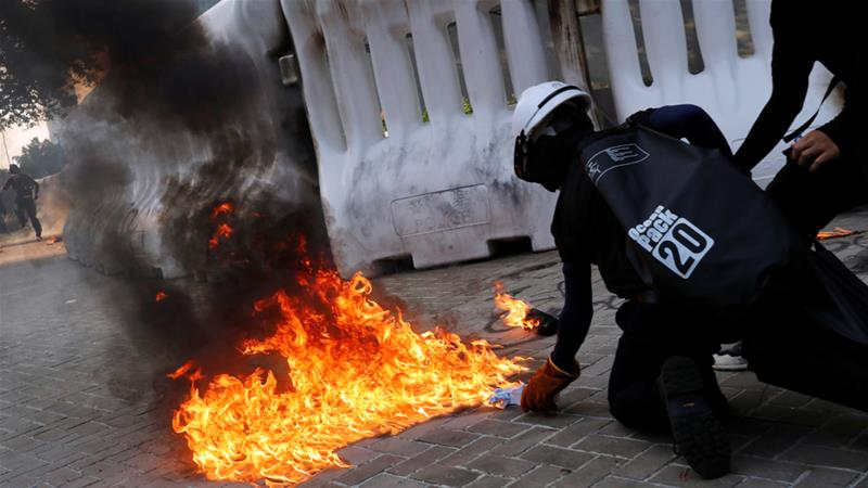 Hong Kong protesters clash with riot police