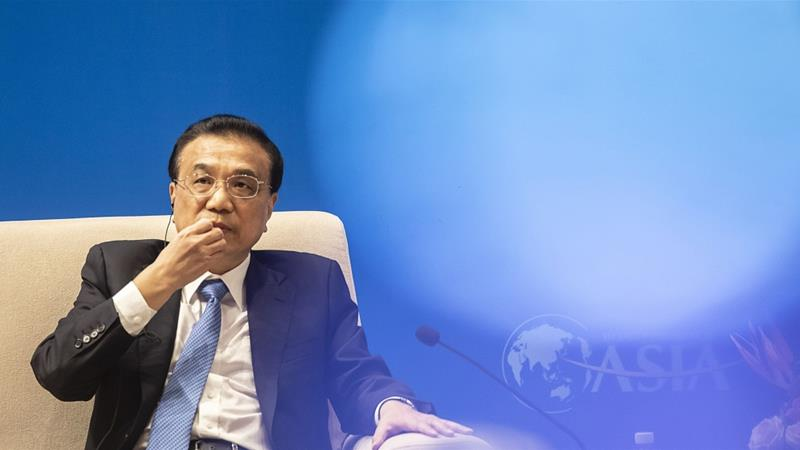 A complicated international backdrop and a relatively high base of growth in previous years are among the headwinds China's economy is facing, its Premier Li Keqiang said [File: Qilai Shen/Bloomberg]