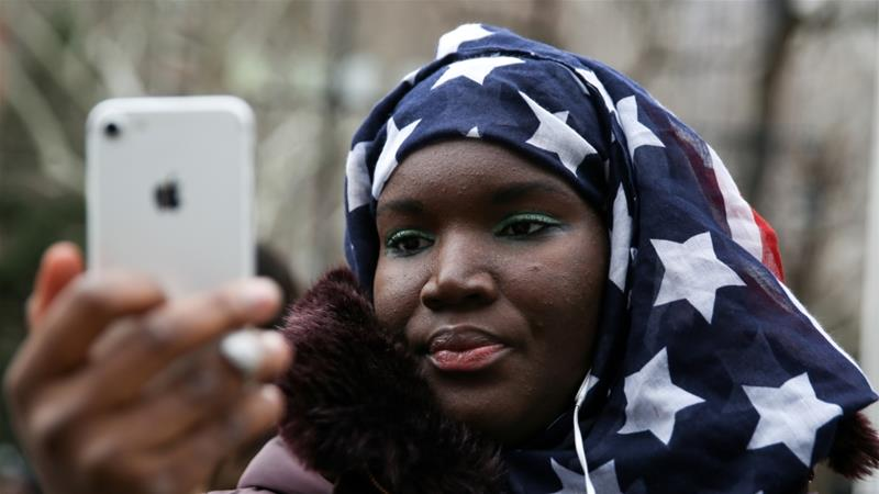 Muslim Senegalese American Fatou Goumbala takes part in a World Hijab Day rally held in front of New York City Hall in Manhattan, New York, US, February 1, 2018 [Amr Alfiky/Reuters]