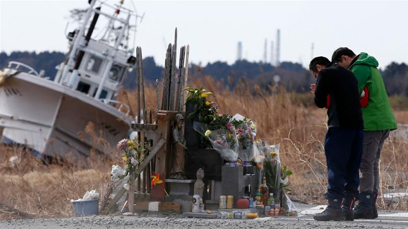 The nuclear disaster at Fukushima Daiichi forced tens of thouands of people from their homes amid the devastation of the tsunami. Few have been able to return except to pray for those who died. [Toru Hanai/Reuters]
