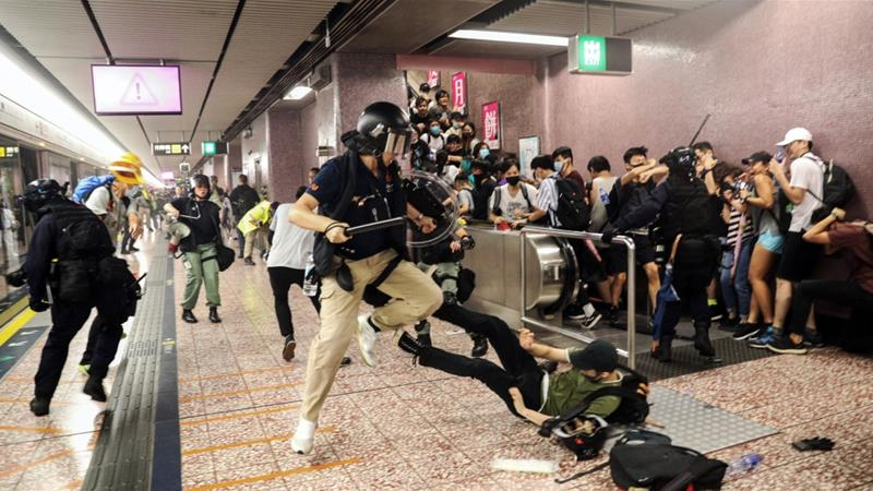 Police said officers were also hurt and that they had exercised 'a high level of restraint... to restore public order' [Ring Yu/HK01 via AP Photo]