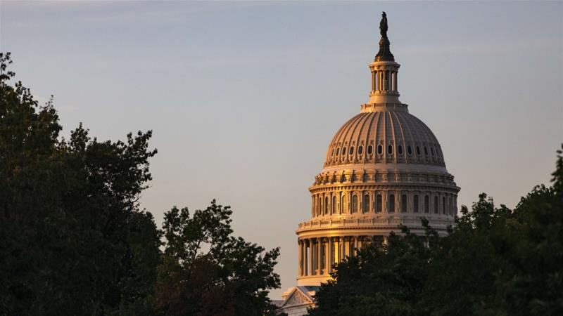 The rising sun illuminates the United States Capitol Building [File: Samuel Corum/Getty Images/AFP]
