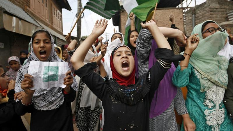Kashmiris shout slogans during a protest after the Friday prayers in Srinagar on September 20 [Francis Mascarenhas/Reuters]