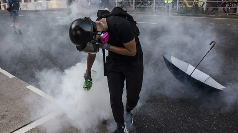 Hong Kong demonstrators clash with riot police