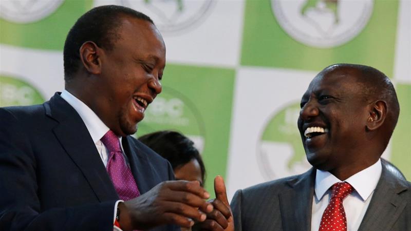 President Uhuru Kenyatta celebrates with Deputy President William Ruto after winning the presidential election  in Nairobi, Kenya on August 11, 2017 [File:Thomas Mukoya/Reuters]
