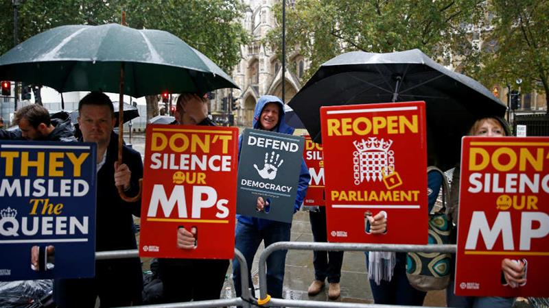 Demonstrators protest outside the Supreme Court in London [Henry Nicholls/Reuters]