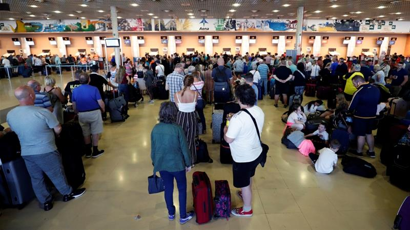 Blame game begins as stranded Thomas Cook travellers return home