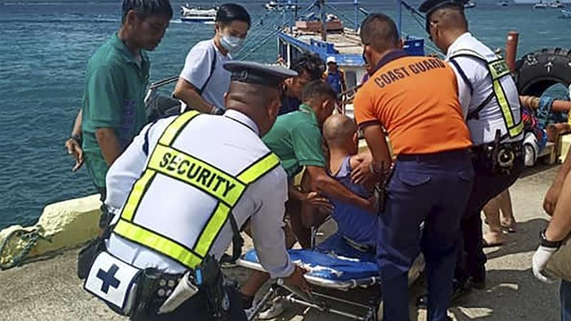 The victims were practicing ahead of an international competition when the accident happened [Philippine Coast Guard/AP]