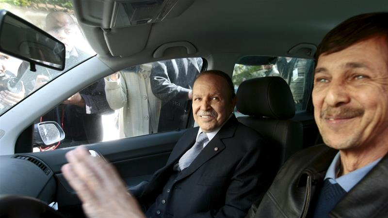 A file picture showing Said Bouteflika, who has been accused of plotting against the state, with his brother, former President Abdelaziz Bouteflika [File: Zohra Bensemra/Reuters]