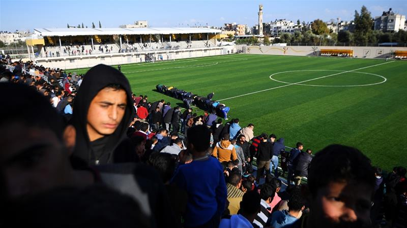 Twelve people from the Gaza club's 35 members, just five of whom were players, were granted permits [Dylan Martinez/Reuters]