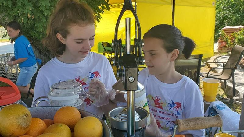 Sisters Hannah and Hailey Hager started a lemonade stand in their North Carolina town to help pay off their classmates' school lunch debt [Courtesy of Erin Hager/Al Jazeera]