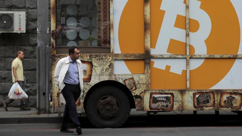 Bitcoin has swung wildly up and down, but its most fervent investors appear confident in prospects for the future [Anton Vaganov/Reuters]