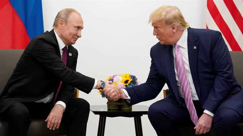 By implicitly applauding Russia for partnering with Turkey to patrol a portion of the Syrian border, Trump seemed to endorse Moscow's ambition to gain greater influence in Syria [File: Kevin Lamarque/Reuters]