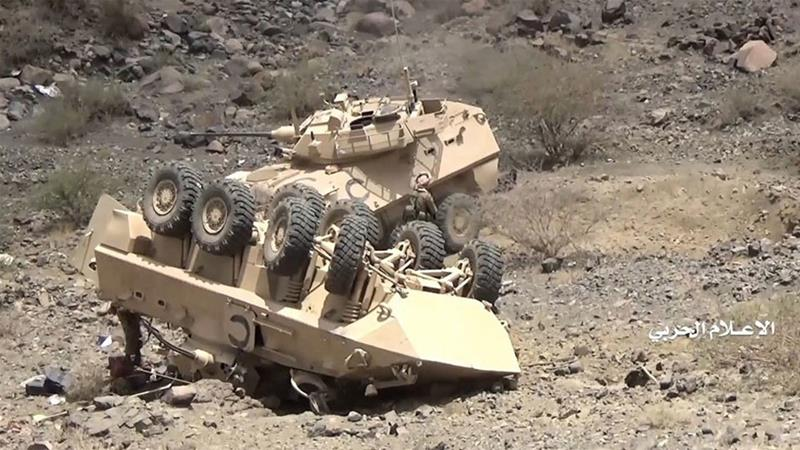 An image grab from a handout video made available by the Houthis allegedly shows Saudi armoured vehicles destroyed by the rebels in an August offensive [EPA]