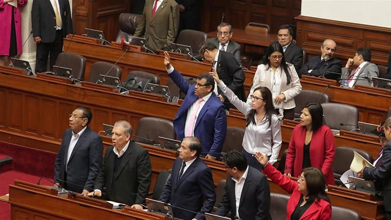 Peruvian politicians react during a session at Congress in Lima, Peru [Guadalupe Pardo/Reuters]
