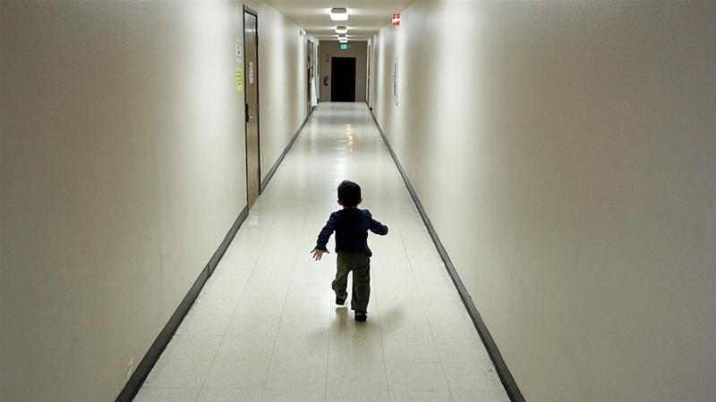 In this December 11, 2018, file photo, an asylum-seeking boy from Central America runs down a hallway after arriving from an immigration detention centre to a shelter in San Diego [File: Gregory Bull/AP Photo]
