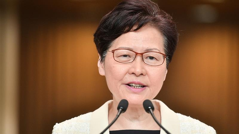 Carrie Lam made the announcement in a pre-recorded video message [Anthony Wallace/AFP]