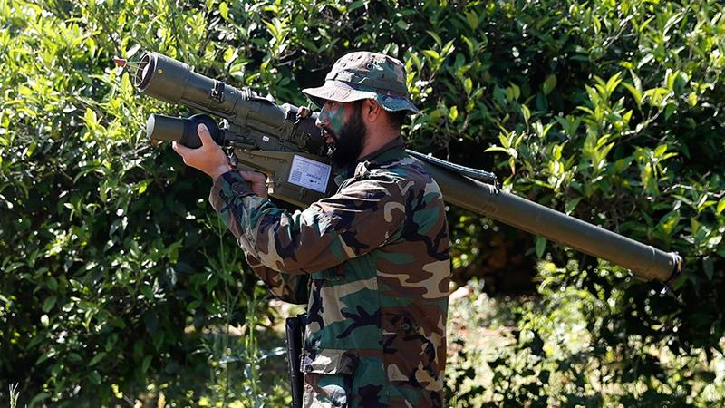 A Hezbollah fighter holds an Iranian-made anti-aircraft missile in south Lebanon [File: Hussein Malla/AP Photo]