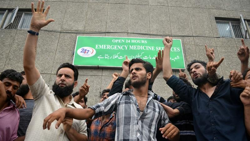 Demonstrators outside a hospital emergency unit during a protest in Srinagar last month [Reuters]