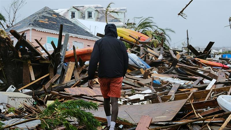 A man walks through the rubble in the aftermath of Hurricane Dorian on the Great Abaco island town of Marsh Harbour, Bahamas [Dante Carrer/Reuters]