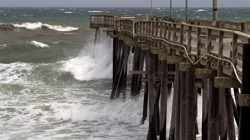Waves crash against Rodanthe Pier as Hurricane Dorian makes its way to Cape Hatteras in North Carolina [Jose Luis Magana/AFP]
