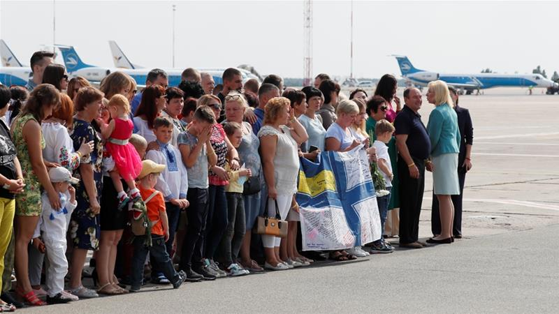 Relatives of Ukrainian prisoners included in the swap wait for their arrival at Borispil Airport outside Kiev, September 7, 2019 [Gleb Garanich/Reuters]