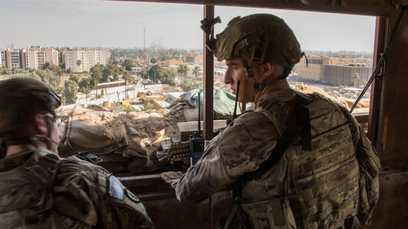 United States soldiers keep watch on the US embassy compound in Baghdad, Iraq on January 1, 2020 [Adrian Weale/Handout via Reuters]