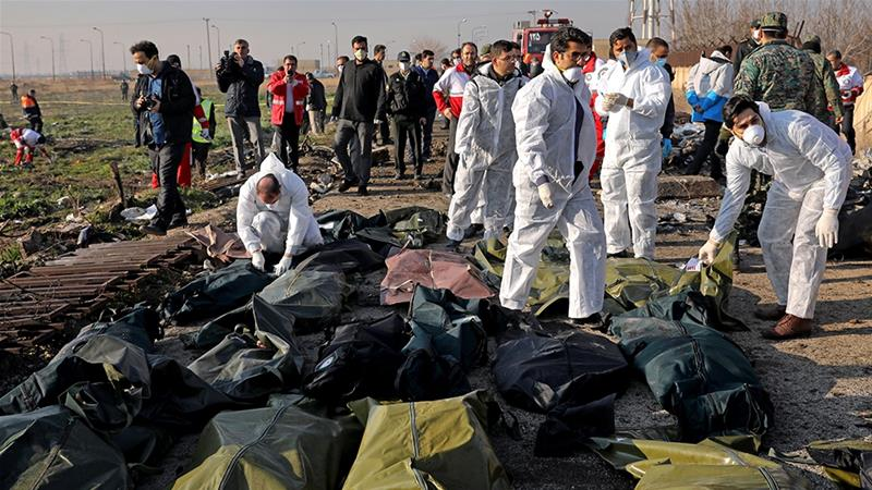 Forensic investigators work at the scene of a Ukrainian plane crash as bodies of victims are collected, in Shahedshahr, southwest of the capital Tehran [Ebrahim Noroozi/AP]