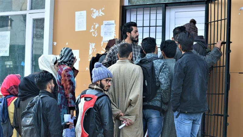People queue outside an internet cafe set-up by the government in Budgam area of Indian-administered Kashmir [File: Athar Parvaiz/Reuters]