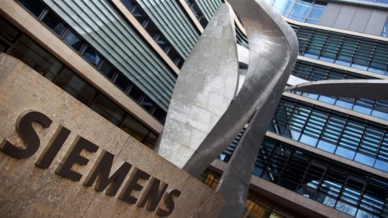 Siemens has pledged to achieve carbon neutrality by 2030 and said it wants to make fossil fuels redundant over time, but environmental campaigners have promised stiff opposition to its participation in the Adani coal mine project in Australia [File: Michael Dalder/Reuters]