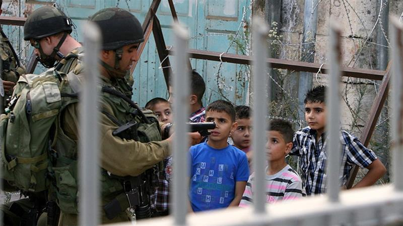 More than 12,000 Palestinian children have been detained by the Israeli army since the year 2000 [File: Abed al-Hashlamoun/EPA]
