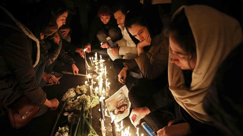 People gather for a candlelight vigil to remember the victims of the Ukraine plane crash, at the gate of Amri Kabir University in Tehran, Iran on January 11, 2020 [AP/Ebrahim Noroozi]