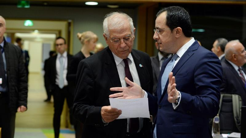 Josep Borrell, left, was speaking to diplomats, including Cypriot Foreign Minister Nikos Christodoulides, before the Foreign Affairs Council meeting in Brussels on Monday [Johanna Geron/Reuters]