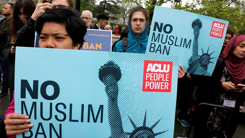 Protesters gathering outside the US Supreme Court, while court justices consider case regarding presidential powers on the legality of President Donald Trump's latest travel ban [File: Yuri Gripas/Reuters]