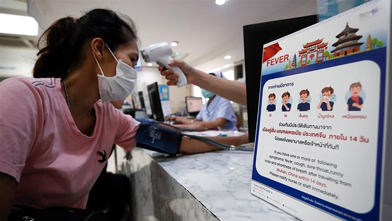 China puts 20 million on lockdown after first coronavirus death outside epicentre