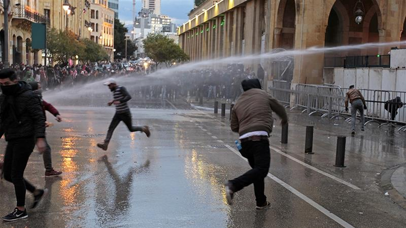 Protesters against Lebanon's newly formed government were sprayed by a water cannon on Wednesday [File: Aziz Taher/Reuters]